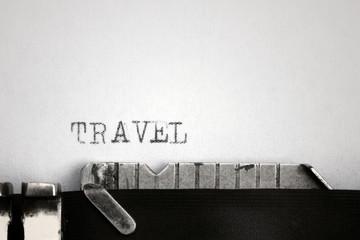 """Travel"" written on an old typewriter"