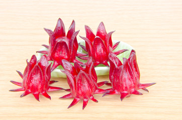 roselle with wooden surface