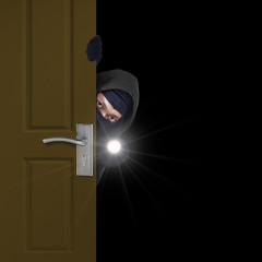 Burglar sneaking through door