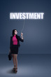Businesswoman holding a investment sign