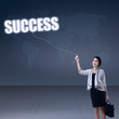 Businesswoman holding word success