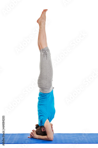Yoga - young beautiful woman doing yoga asana excerise isolated
