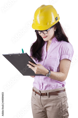 Female supervisor making checklist