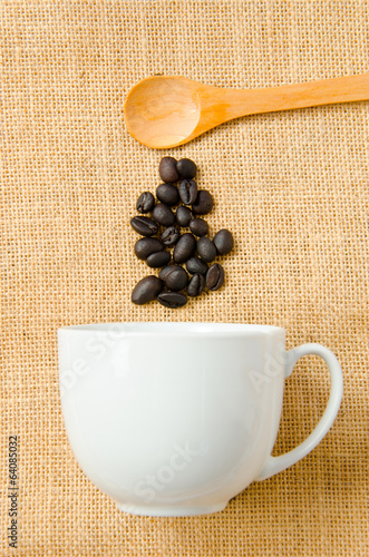 Wooden spoon and a cup of coffee