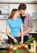 couple hugging in the kitchen
