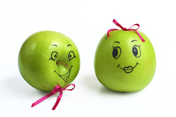 apples with comically painted faces on a white background