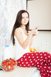 Girl in pajamas having breakfast