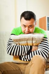 sad man   hugging  pillow