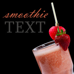 The strawberry smoothie on a black