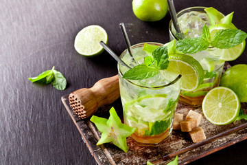Fresh mojito drinks on black stone