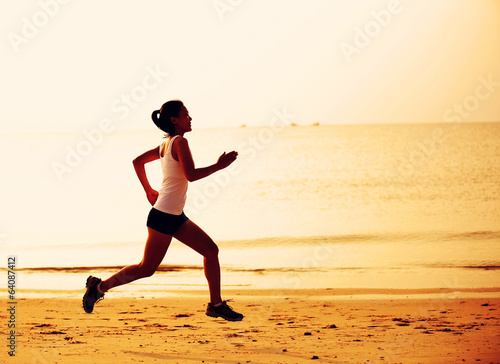 Runner athlete running at seaside
