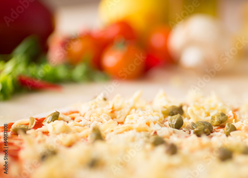 raw italian pizza with capers
