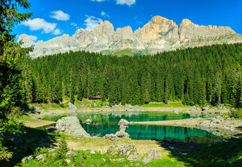 Beautiful Carezza lake in the forest,Dolomites,Italy