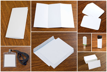 white collection of stationery on wooden background.