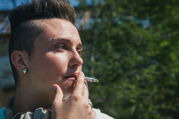 Portrait of short hair girl smoking
