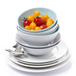 bowls, plates, cutlery and cherry tomatoes, isolated