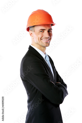Happy businessman in helmet with arms folded