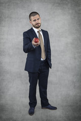 businessman with fruit in hand