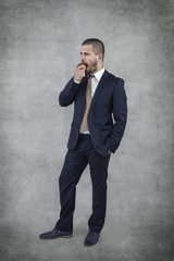 young handsome businessman eating an apple