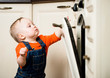 Baby watching inside kitchen oven
