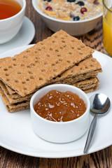 delicious breakfast - crisp bread with orange jam, close-up