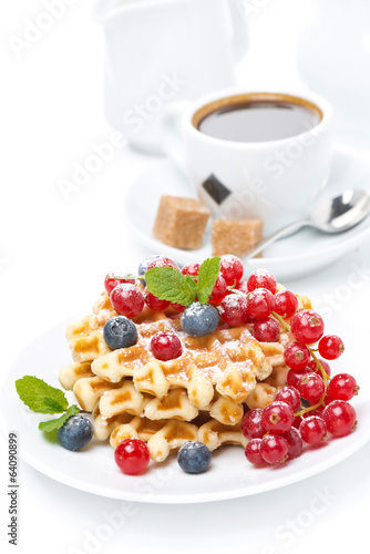 delicious breakfast with Belgian waffles, berries and coffee
