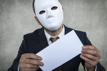 incognito businessman holds an envelope with bribe