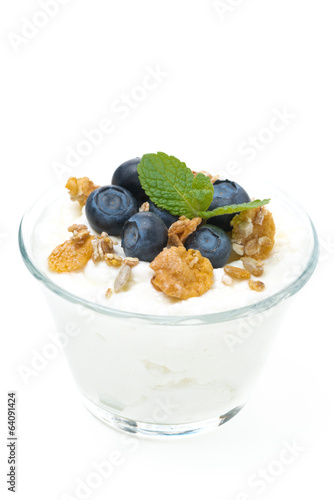 fresh yogurt  with muesli and blueberries in a glass, isolated