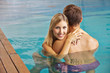 Couple embracing in swimming pool