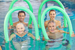 Group of senior people with swim noodles