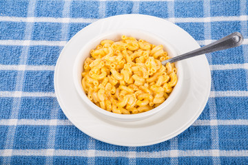 Mac and Cheese in White Bowl on Blue Towel