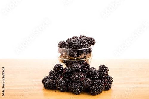 Glass Cup of Blackberries on Table