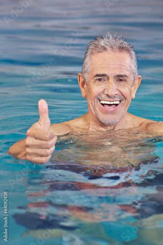 Happy old man in swimming pool