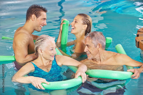 Group in swimming pool doing aqua fitness