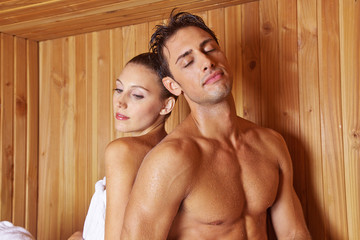 Couple in sauna leaning on each other