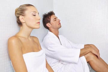Woman and man relaxing after sauna