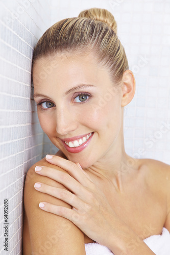 Smiling woman in bathroom