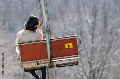 lonely girl on the chair lift