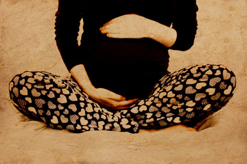 Young pregnant woman. Stylized photo in old color image style.