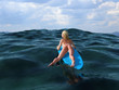 woman floating on a surfboard