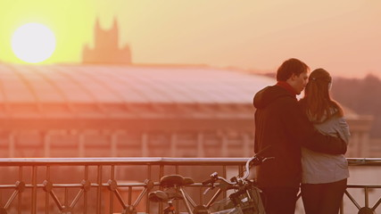 Loving couple outdoor at sunset