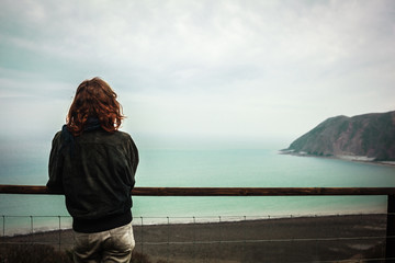 Young woman admiring the seaside view