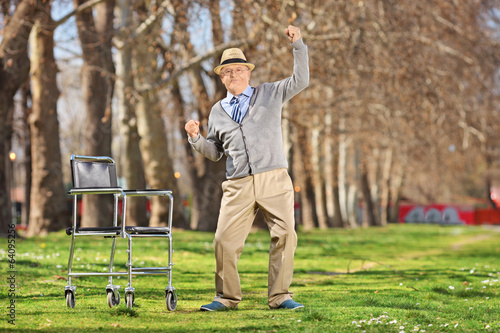 Overjoyed senior man standing up from a wheelchair