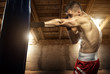 Young man boxing, exercise in the attic - 64095485