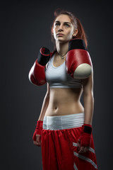 Boxing woman standing in dress boxing