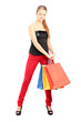 Trendy woman holding shopping bags