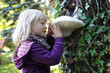 Little caucasian girl examining large Tinder fungus