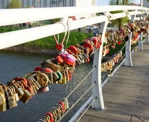 Hanging wedding locks on the railing of the bridge
