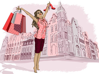 Fashion girl with shopping bags on a city-background