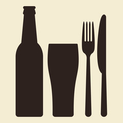 Bottle, glass of beer and cutlery
